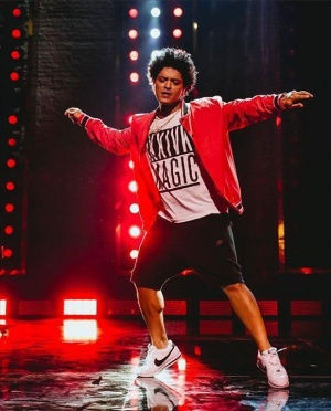 Hooligans! Go to brunomars.com and check out the coffee table book with exclusive photos we put together from our performance at The World Famous @apollotheater. Here's one of me dancing.... I like to dance......dance