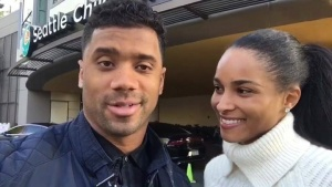 'Tis The Season To Be Giving! Russell Wilson and I felt good spreading this love through the halls of Seattle Children's with @Starbucks today! ❤️